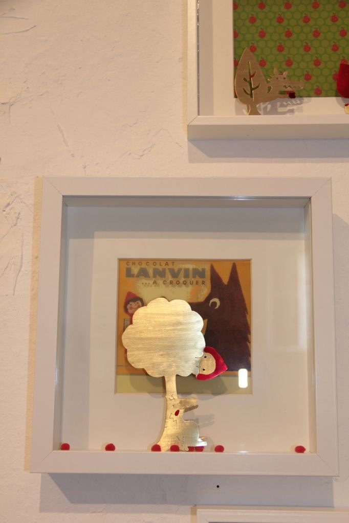 Stuffed Wolf lying under the apple tree with a peek-a-boo Little Red Riding Hood. €75.00, via Etsy.
