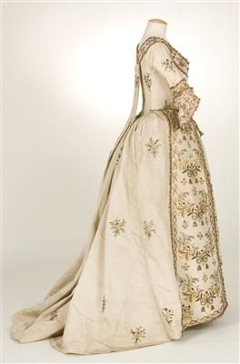 Side view Sacque gown a la Piedmontese, ca. 1780, Italy (?), plain cream ribbed silk, metallic and silk embroidery.  Metallic lace borders all the embroidery elements.