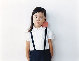 Osamu Yokonami and his 100 Children project is inspiring in its simplicity and beauty