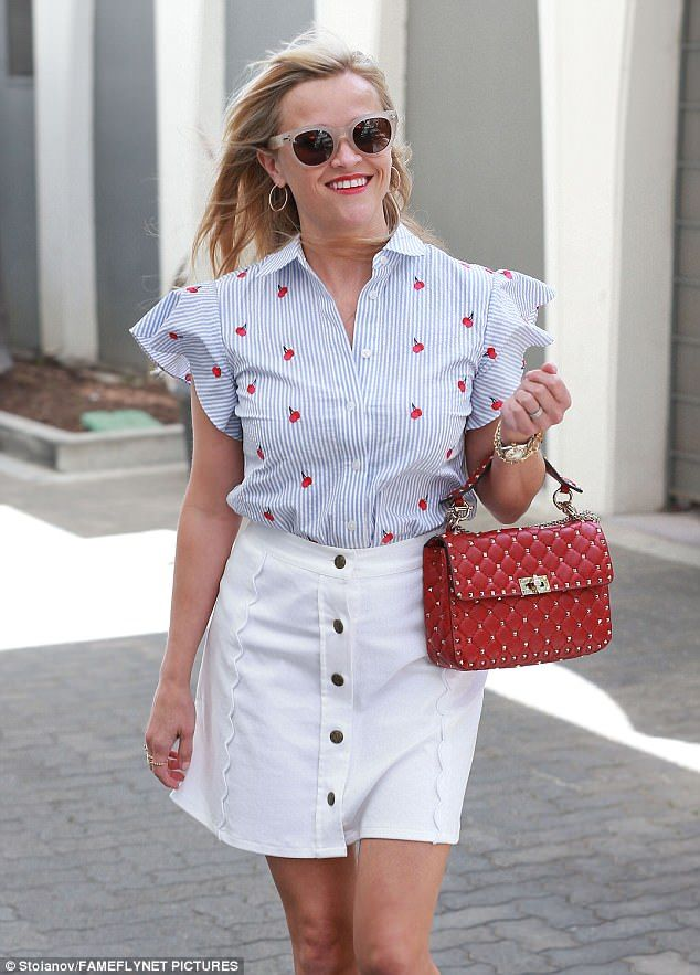 Cheery in cherry: The Legally Blonde actress flashed a smile on her day of work...