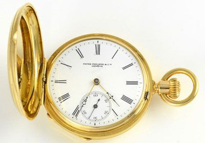 Antique Swiss hunter case pocket watch by Patek Philippe, circa 1880. The case is set in 18 karat yellow gold monogrammed CN with original white enamel dial and sub seconds dial. Serial #33631, 38mm case. Restored with a one year warranty.
