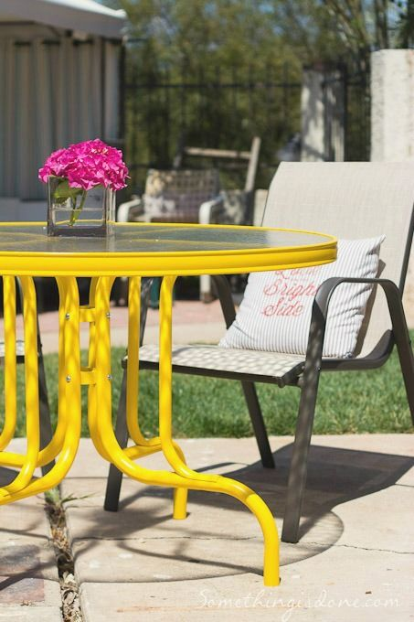 yellow patio table - love the idea of refreshing an old patio table with a fun colour...but maybe not yellow.
