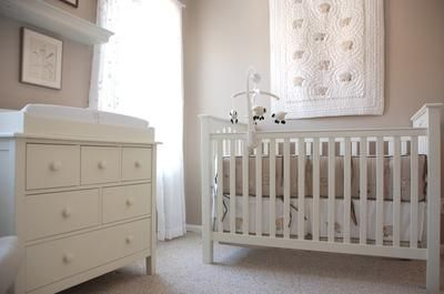 """Beautiful taupe and white baby girl nursery with a Pottery Barn Kids Kendall crib and dresser and """"Lambie"""" baby bedding set."""