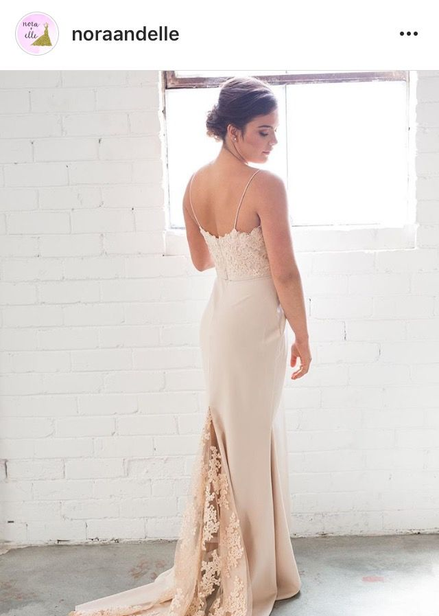 One of our beautiful Jadore numbers. Fit to the body with lace train detail. Available now at Nora and Elle.