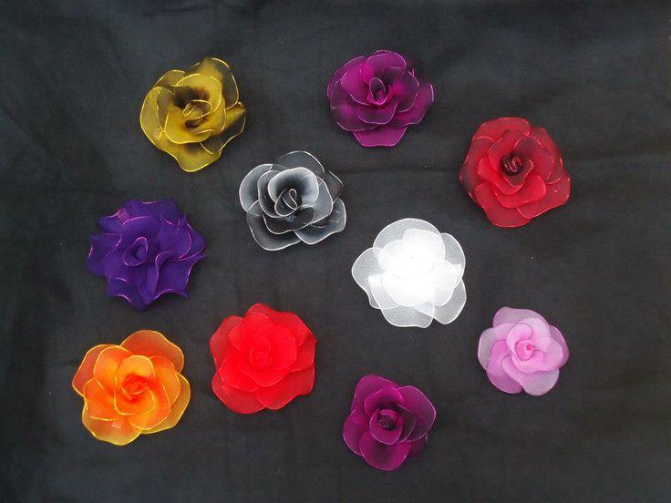 Fermagli con fiori colorati completamente fatti a mano con filanca setata per essere uniche e distinguersi!