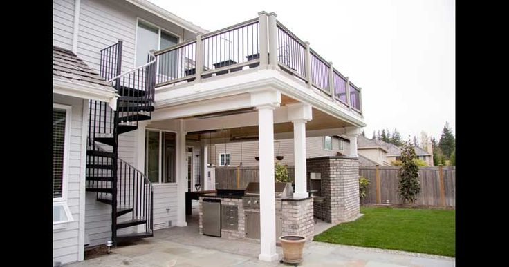 Love this outdoor patio deck with spiral staircase and outdoor kitchen underneath