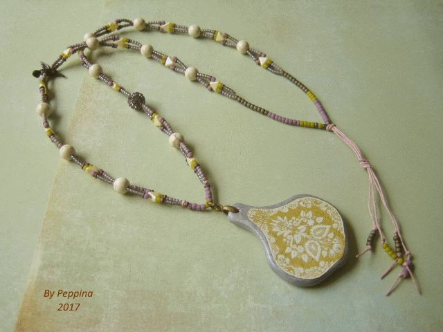 PMC and decoupage pendant, seed beads, Kheops par Puca and Howlite beads. Designed and made by Peppina Pöyhönen.