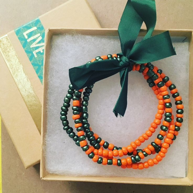 Football bracelet set miami hurricanes canes university of miami UM florida stack stackable by FlamingoStreetStudio on Etsy https://www.etsy.com/listing/486675419/football-bracelet-set-miami-hurricanes