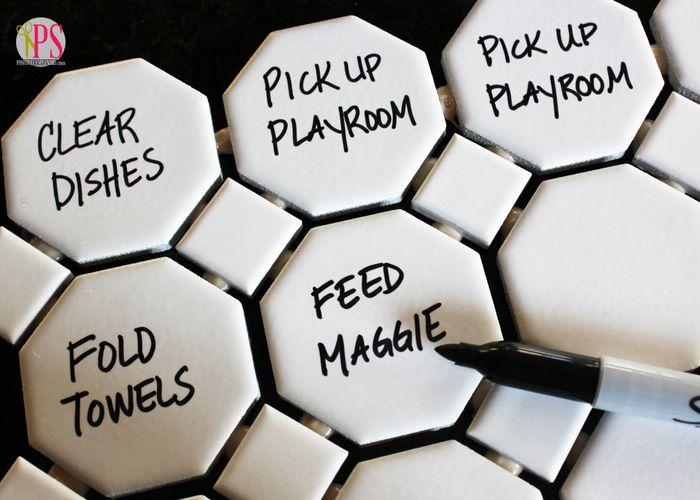 Hexagonal tiles on a magnetic chore chart
