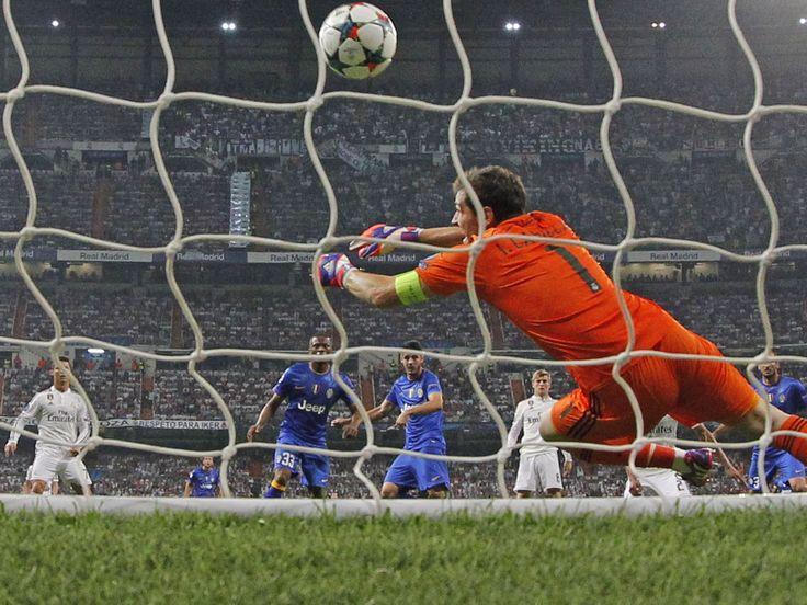 Juventus' Alvaro Morata, scores past Real Madrid goalkeeper Iker Casillas.  Daniel Ochoa de Olza, AP