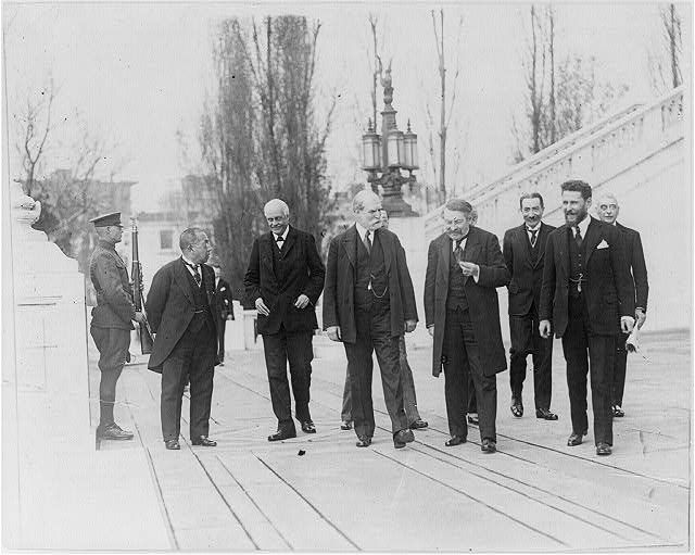 "[Members of World Disarmament Conference, Washington, D.C., 1921: Members of the ""Big Nine"" walking on plaza - Charles Evans Hughes in middle]"