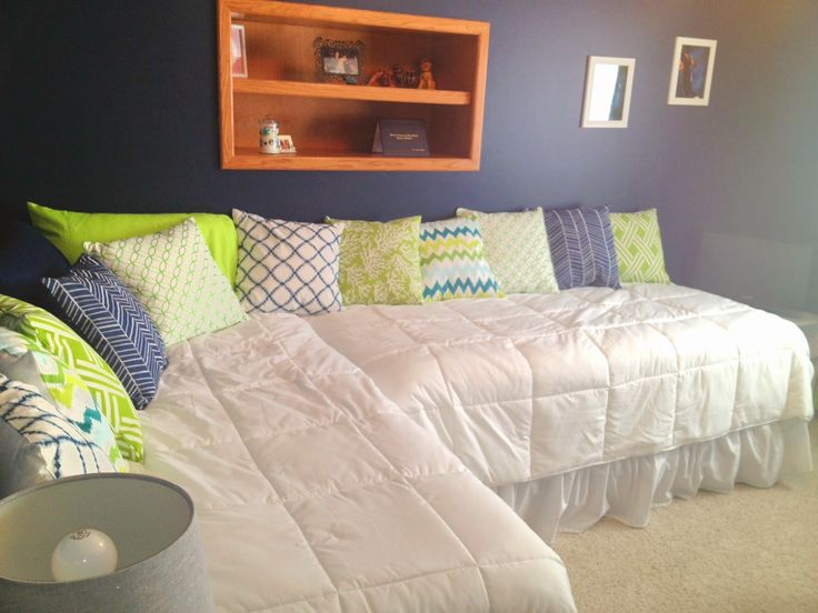 Bedroom makeover.  2 twin beds l-shape.  Throw pillows.  White bedding.  Navy walls. Lime Green, White, Grey accent colors.