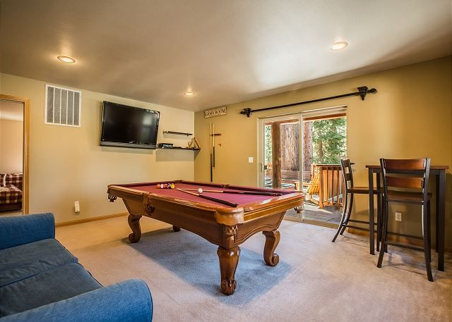 Regulation pool table, HDTV, Blue Ray DVD, sofa bed, sliding door to mid-level deck with hot tub