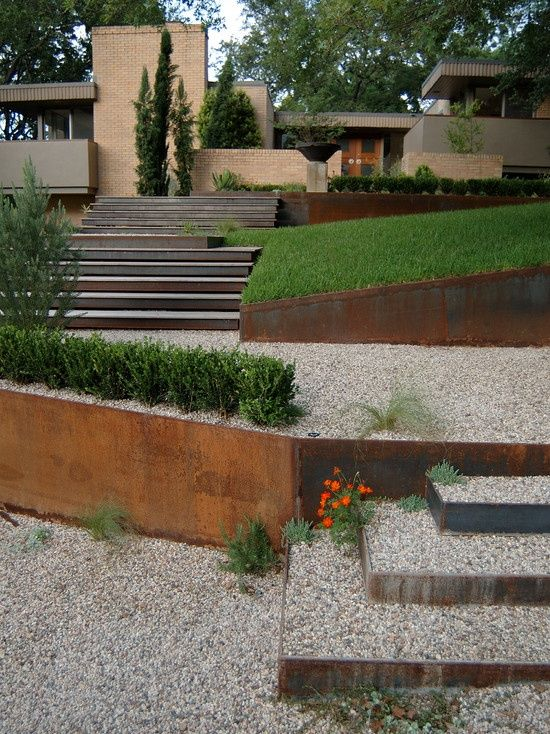 Corten steel as retainint wall veneer and stairs.  Ground cover and DG/step stones instead of gravel.                                                                                                                                                                                 More