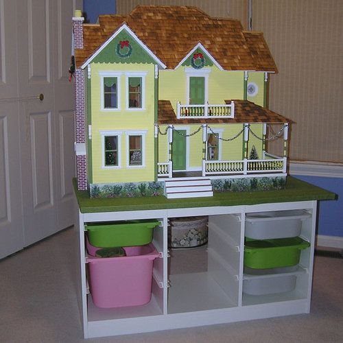 A piece of Ikea storage furniture for a child's room is used as a dolls house stand with storage.