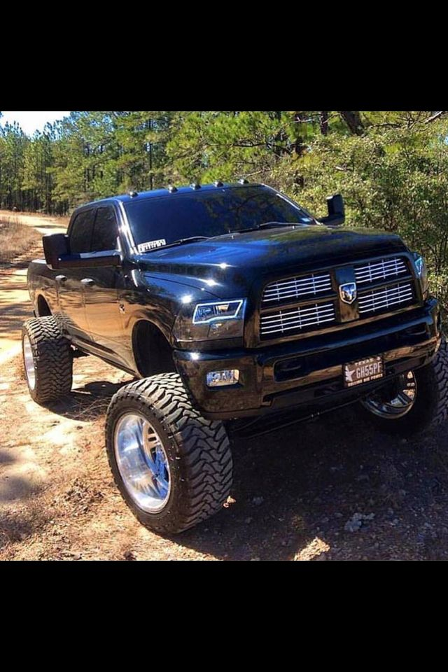 Respect to this Black Beauty! Black Dodge Cummins #Dodge #Cummins #Lifted #ChromeWheels #Lights #Suspension