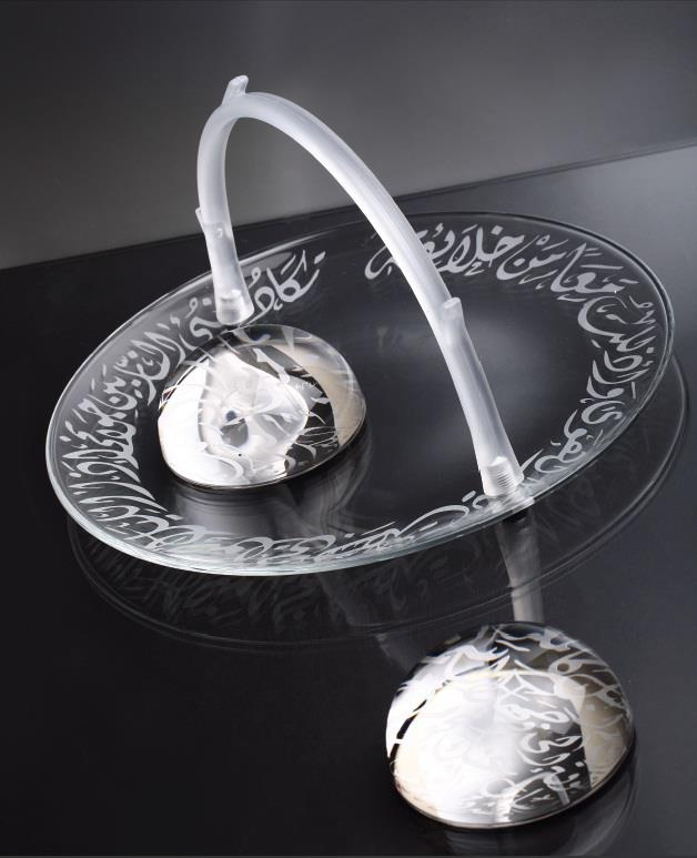 Divine tableware inscribed with Arabic calligraphy by Dimlaj Gallery.