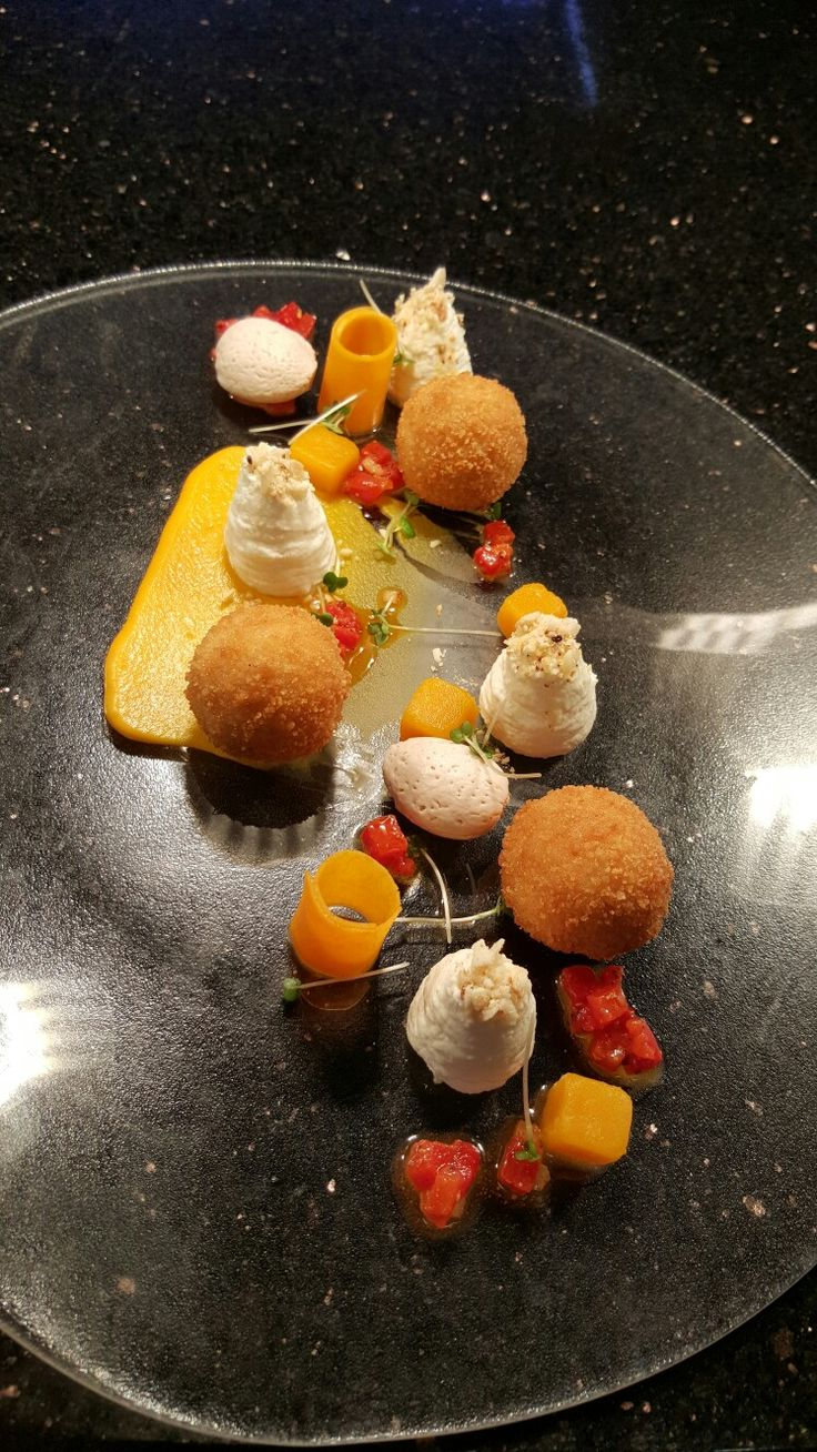 Ardsallagh goat's cheese beignets, tastes and textures of butternut squash, red pepper dressing, almonds