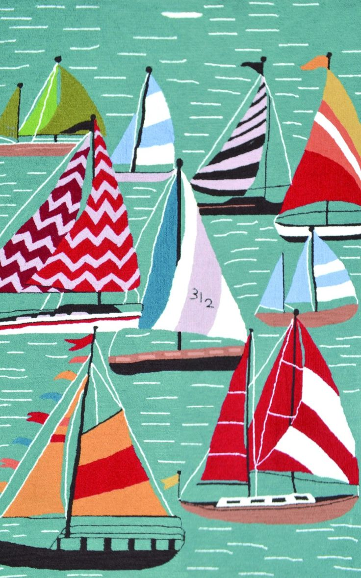 Colorful sailboats would be a pop of nautical color at your beach home.