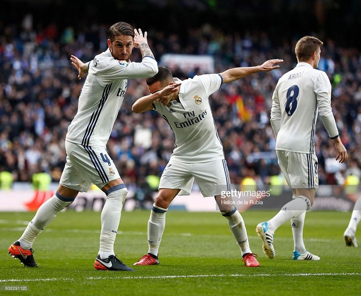 Sergio Ramos (L) and Lucas Vazquez of Real Madrid celebrate after scoring during the La Liga match between Real Madrid and Malaga CF at Estadio Santiago Bernabeu on January 21, 2017 in Madrid, Spain.