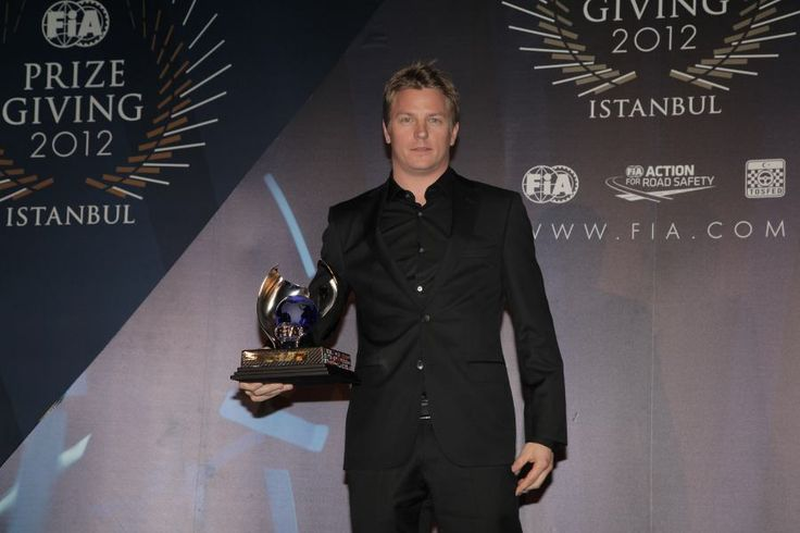 Kimi Raikkonen receives his award for third place in the drivers' championship at the FIA prize-giving gala