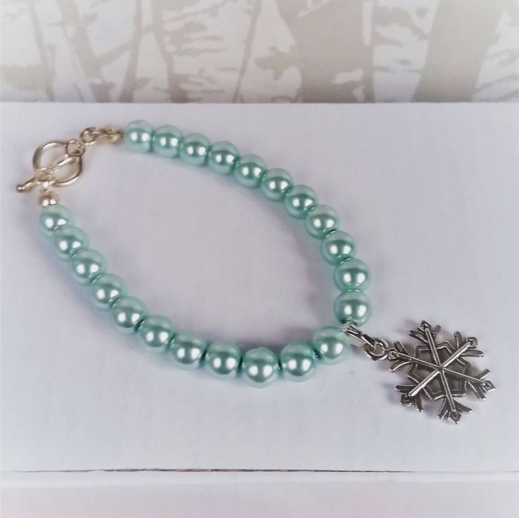 Childrens Blue Snowflake charm bracelet with glass pearls by AccessoriesShine on Etsy