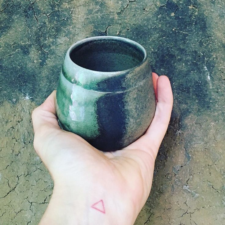 This little gem is on eod my new fav cups to drink from. It's a soda fired stoneware  cup glazed with my all time fav Black Leather cone 10 glaze. It's a goodie! Love the emerald green from where the soda hit the cup during the firing. #stoneware #wheelthrown #ceramics #art #pottery #claycrits #ceramic #clay #handmade #tableware #instaart #instagood  #instafollow #followback #artdesign #pottersofinstagram #love #photooftheday #ceramicsmagazine #design #homedecor #arts_help #artsamazingz…