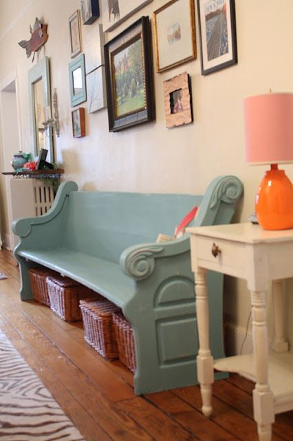Painted church pew... only in antique distressed white, with a blue cushion and accent pillows to match the front door and accents on the house. Plus probably cheaper than rocking chairs. I like the idea of the little table next to it too. Again same color with something blue on top.