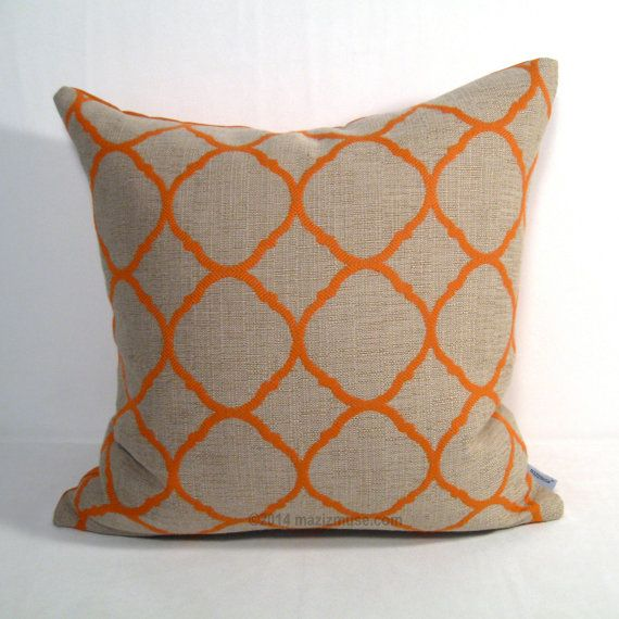 Sunbrella pillows with a modern ogee design in orange on an antique beige background.  Looks and feels like linen but will withstand years of hot summer sun!