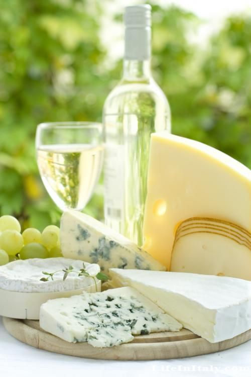 lovely cheese tray with green grapes and white wine. summer ~ party ~ snack ~ romantic treat ~ great date ~ bright & beautiful.