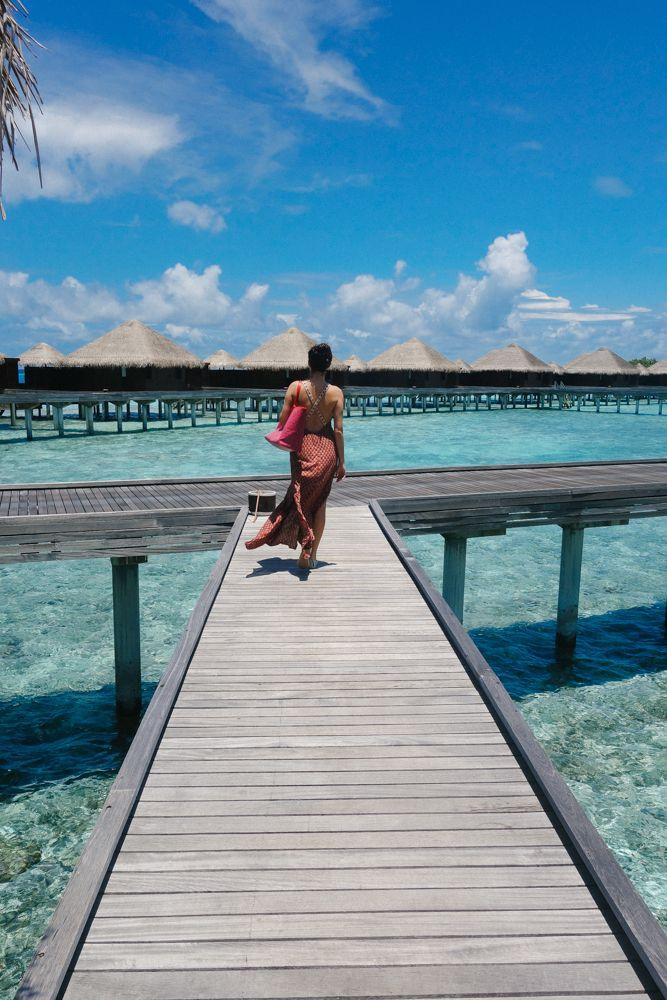 Walking to the water villas at Huvafen Fushi, Maldives.