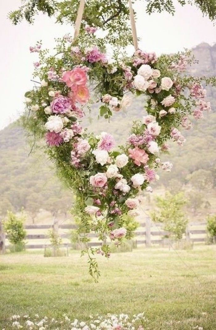 What is more romantic than a heart shaped wreath made from stunning florals? Photo via Weddbook