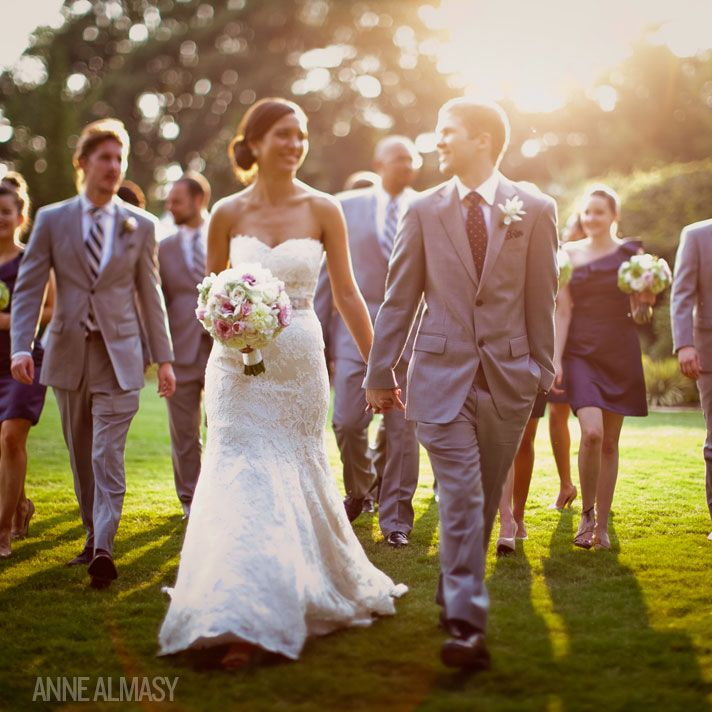 This is definitely a photo I want to have of the wedding party walking behind the Bride and Groom.