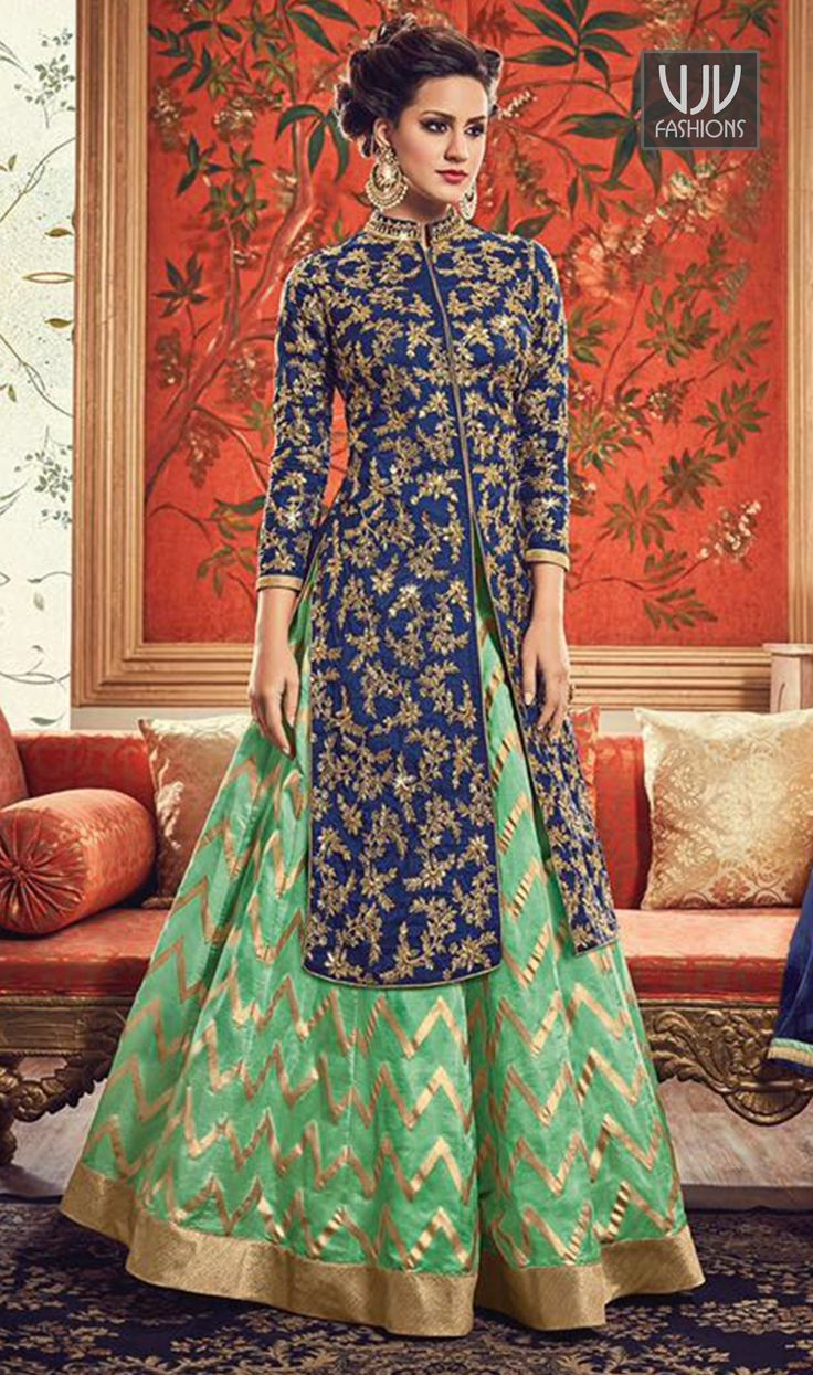 Awesome Sea Green And Blue Color Banarasi Lehenga Style Suit  You will be the center of attention in this attire. Real beauty comes out from your dressing style with this sea green and blue color banarasi designer lehenga style suit. This lovely attire is looking extra beautiful with embelishment of embroidered and lace work.