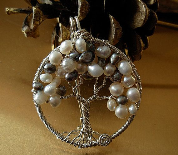 White and Grey Freshwater I designed and handcrafted this Tree of Life as a versatile piece of jewelry. You can wear it as a pin or as a pendant on a silver chain.  An intricate and painstaking piece in wire-wrapping technique using Sterling silver wire creating the roots, trunk , branches. I combined white and grey freshwater pearls to represent the leaves.  It looks amazing as a necklace and beautiful pined on a shawl. Elegant gift $ 155 Hand-crafted by Raquel Chelouche