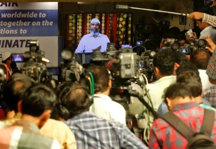 Hardline preacher finds refuge in Malaysia as politicized Islam grows KUALA LUMPUR (Reuters) - When Zakir Naik emerged from a prominent Malaysian mosque last month fans swarmed about him, seeking selfies with the Indian Muslim televangelist whose hardline views have sparked a criminal investigation back in his home country.