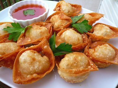Chinese Fried Won Tons. Crunchy, savory, and so delightful these popular appetizer morsels really go quickly at any dinner party! Be sure to make several batches.