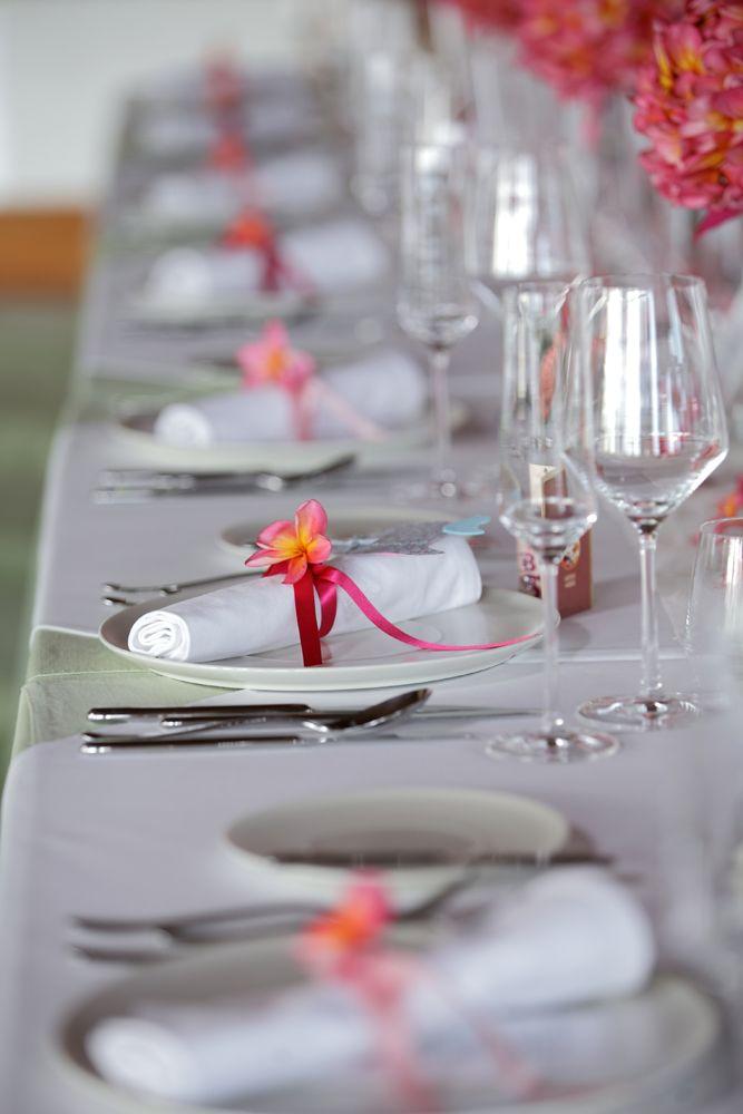 Napkin ring tied with pink ribbon and Frangipani by Tirtha Bridal Uluwatu Bali