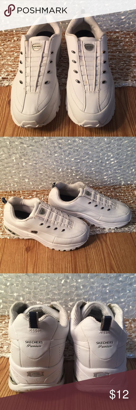 White Skechers Premium sport sneaker. Slip-on White Skechers Premium sport sneaker with silver and navy blue markings. Slip-on Gently used. Size 9 Skechers Shoes Sneakers
