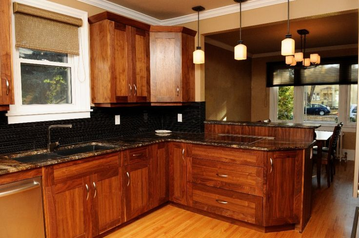 Cherry wood shaker kitchen with granite counter tops and hardwood floors