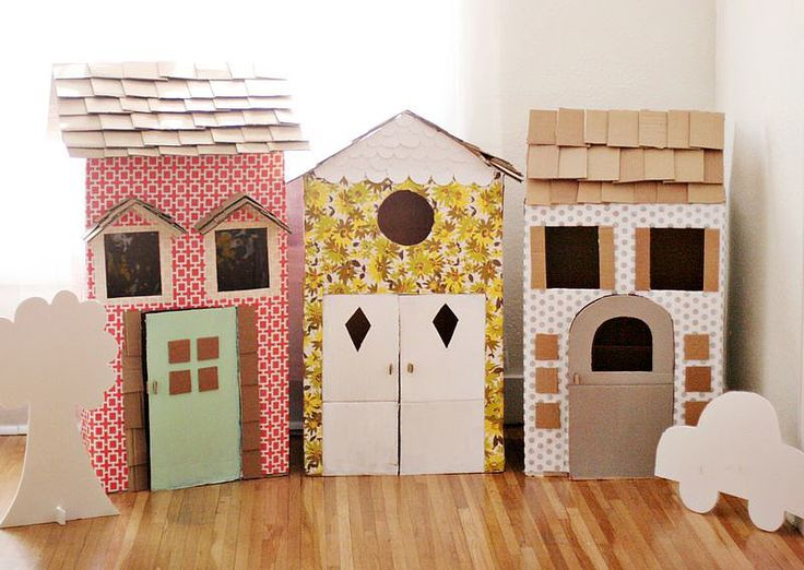 Elsie of A Beautiful Mess created these DIY playhouses for her daughter's second birthday party using large cardboard boxes, a box knife, wallpaper, wrapping paper, paint, masking tape, hot glue, and double-sided tape. So cute!  Source: A Beautiful Mess