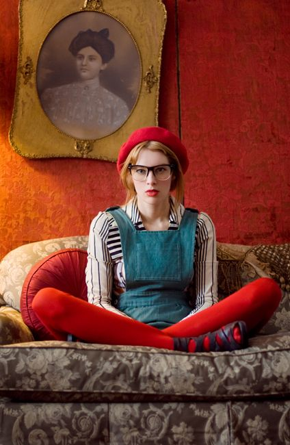 Not those glasses though... he he....looking bored in red tights and French beret