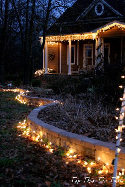 Top This Top That: Outdoor Holiday Lighting Ideas. I love lights on the ground framing the garden