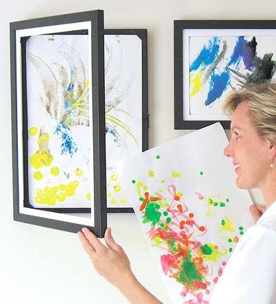 This frame holds 50 pieces of artwork and has a latch on the front! Perfect for displaying your child's most recent masterpiece. So smart!