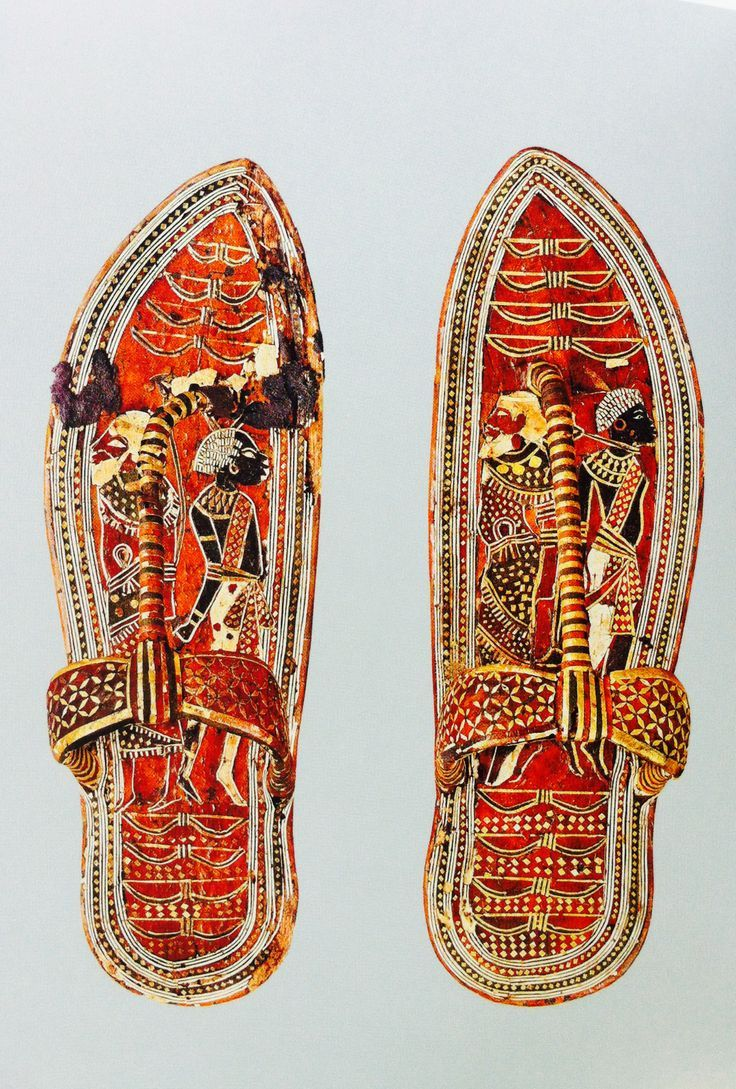 Ancient Egyptian sandals made of wood with leather bark and gold embellishments