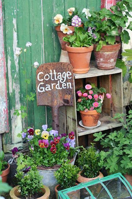 Cottage garden mismatching pots pretty garden small for Pretty small garden ideas