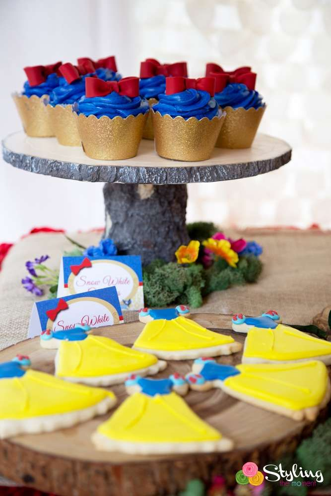 Beautiful cookies and cupcakes at a Snow White birthday party! See more party planning ideas at CatchMyParty.com!