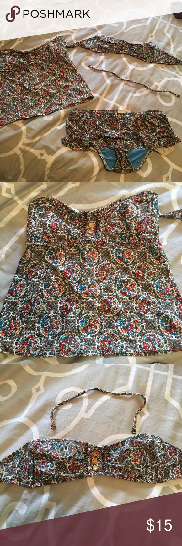 Lucky Brand 3 piece swim wear Paisley printed suit with wood button and bead accents. Skirted bikini bottom size L. Tankini top size M. Bandeau top size S. Both tops can  be worn strapless or with the removable strap included. Bottoms are missing two buttons... but it isn't very obvious when worn. Easy fix too! I am petite with 34C-- and a booty. That's why the sizes are all different! Purchase together or I can make a separate listing for what you want :) Lucky Brand Swim Bikinis