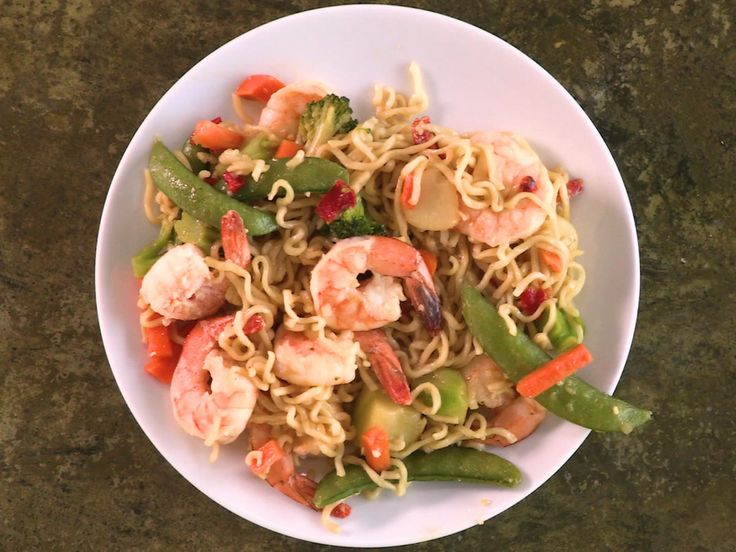 Shrimp and Ramen Stir-Fry | The college student's standby gets a serious upgrade in this tasty stir-fry supper. Using quick-cooking, packaged ramen noodles (minus the seasoning packet) as a base, simply bulk them up with frozen shrimp, veggies, and a quick and flavorful homemade sauce to create a weeknight-friendly dinner. Added bonus: The leftovers make for an excellent next-day packed lunch.