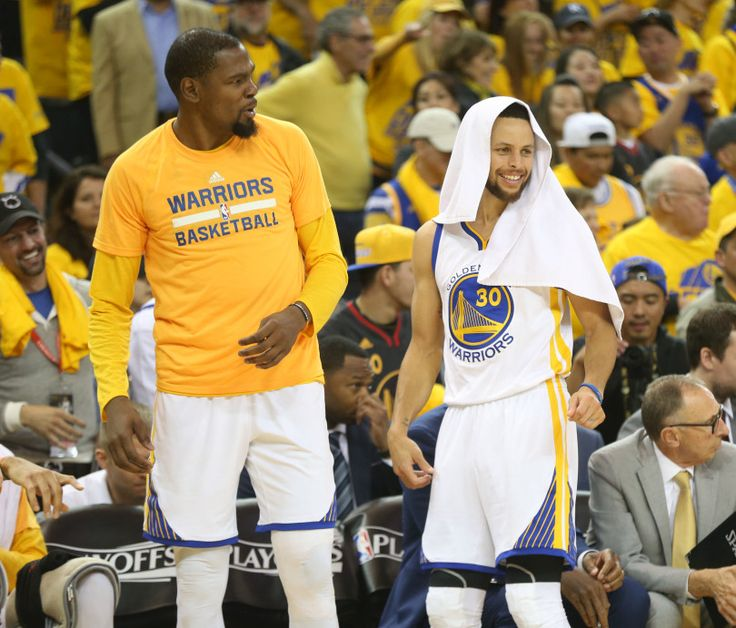 The Golden State Warriors' Kevin Durant (35) and Stephen Curry (30) react on the bench against the Portland Trail Blazers in the fourth quarter of Game 1 of their NBA first round playoff series at Oracle Arena in Oakland, Calif., on Sunday, April 16, 2017. (Ray Chavez/Bay Area News Group)